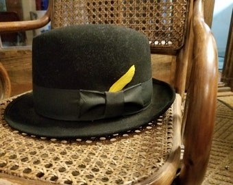 52c1a2278f25 Men's black fedora, yellow feather. 21 inch inner leather band, one and a  half inch wide outer band. Great vintage shape.