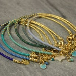 The SNAKE bracelet - dainty, colorful, glass seed beads, stackable bracelets, blues, turquoise. Stack them! the more the merrier!