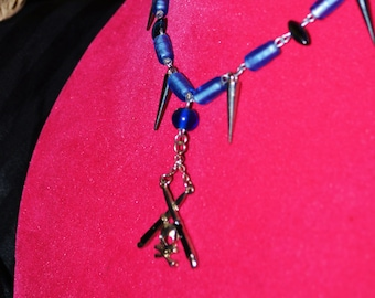 blue beaded necklace with skull and switchblade pendant
