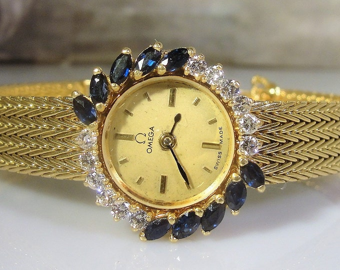 OMEGA 18K Gold Diamond and Sapphire Ladies Wrist Watch that is Battery Operated, Vintage Wrist Watch