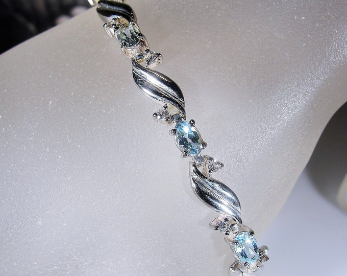 Tennis Bracelet, Vintage Sterling Silver Pale Swiss Blue Topaz and Cubic Zirconia Tennis Bracelet