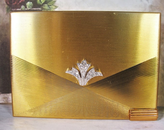 1940s Musical VOLUPTE Gold Tone  Compact with a Rhinestone Fleur-De-Lis Accent and Slide-In Lipstick Holder and Powder Puff
