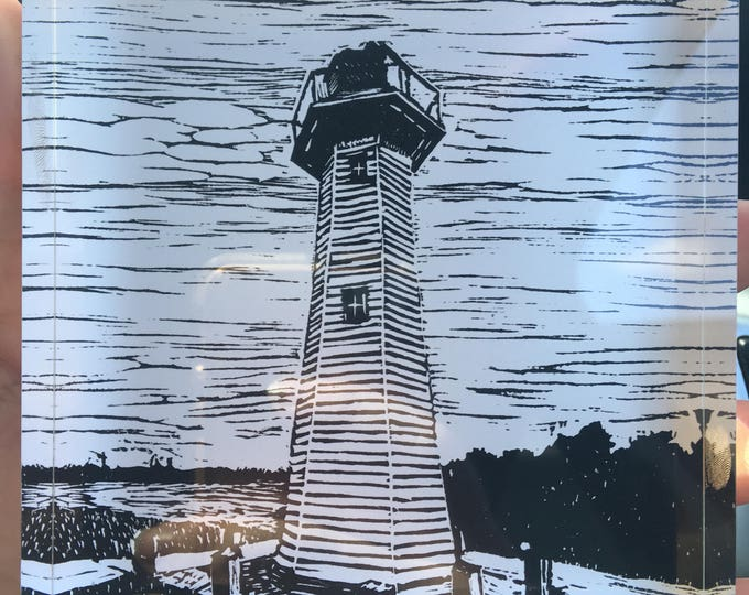 Crystal block of my linocut of the Cleveland Lighthouse