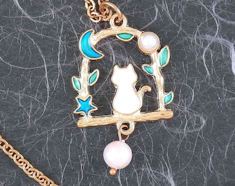 Mid-length necklace with tiny enamelled white cat sitting on a branch with blue moon and star on rose gold hypoallergenic stainless steel