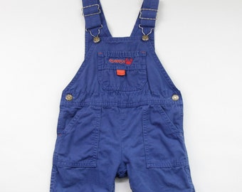 40dbe9d8416 90s 00s Era Vintage OshKosh B Gosh Blue Canvas Cotton Overalls w Adjustable  Straps + Snap Legs