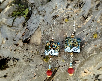 Multicolored dangling glass  and wood bead earrings by Dorje Dolma