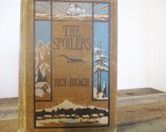 Rare First Edition Cover of The Spoilers by Rex Beach - Published in 1906. Lovely Vintage Book with Ornate Binding.