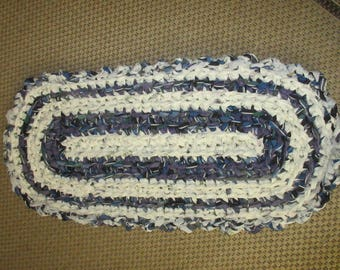 Rag rug, crocheted rag rug, purple and white, Measures 17 by 35 inches.  JW211