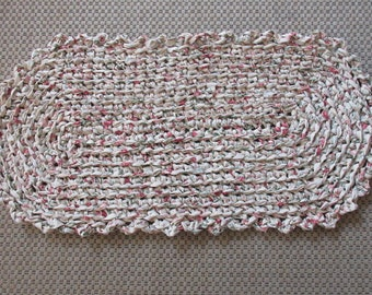 Rag rug, crocheted rag rug, light tan, burgandy, rose and a little green. Measures 18 by 36. Shipping included    JW230