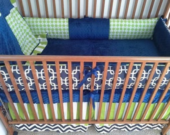 Navy and lime baby bedding.