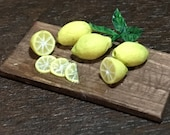 Handmade fresh lemons on a cutting board 1:12 scale