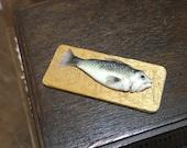 Fish on a cutting board 1...