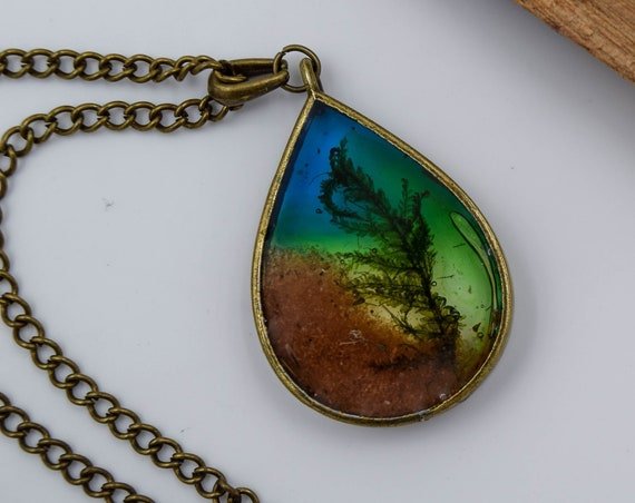 Resin landscape pendant, antique bronze, organic jewelry with real mosses and sand of the Sahara desert