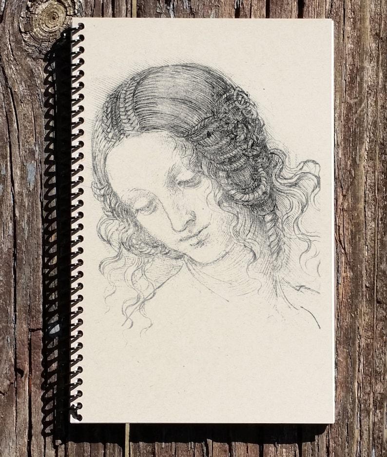 statue of leonardo da vinci journal 150 page lined notebook diary