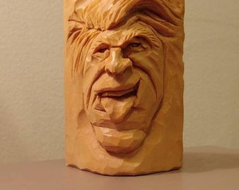 Wood carved Spirit Face with tongue out