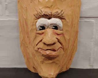 Wood carved Face caricature painted with cartoon eyes