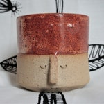face-pot: burnt orange and flecked clay