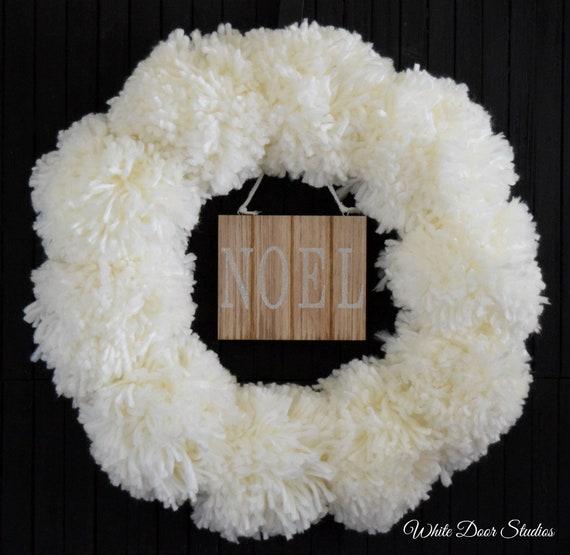 Creamy White Pom Pom Christmas Wreath with Noel Sign
