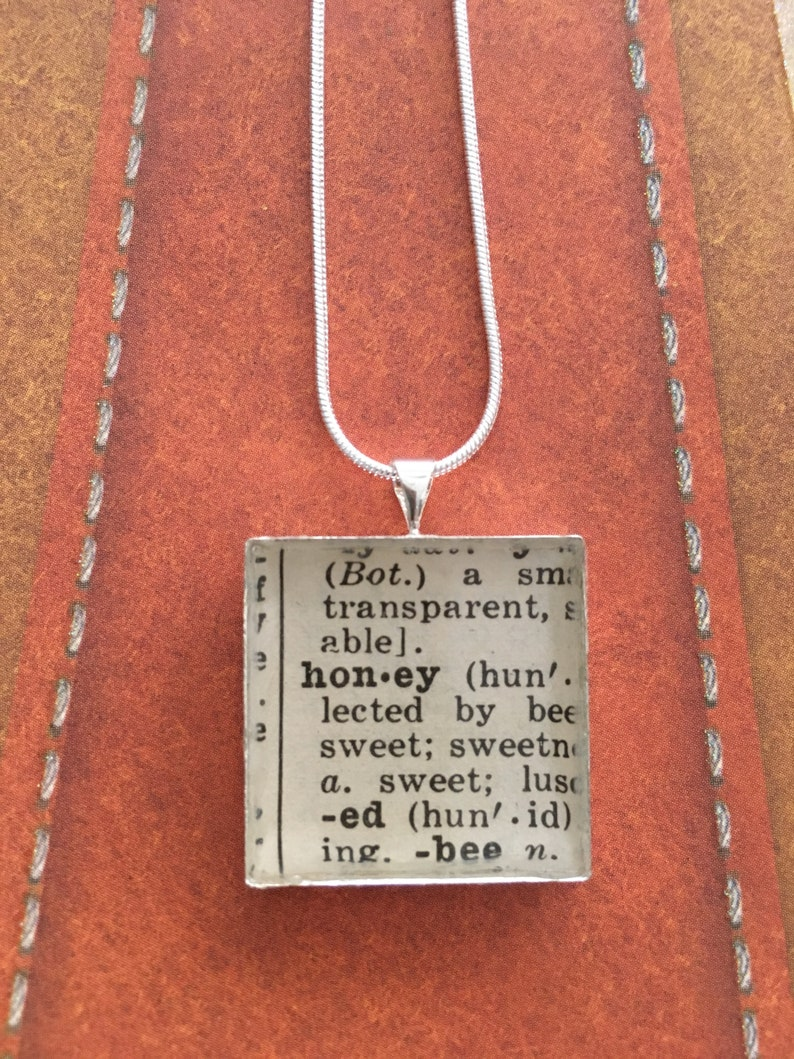 Honey Necklace Made From Reused Dictionary Pages. Presents image 0