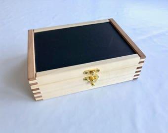 Straight razor storage box for seven razors. Handmade from pear and tulip wood with black vinyl inlay.
