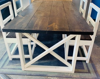 Rustic Farmhouse Table With  and Ladder Back Chairs with Dark Walnut Top and Weathered White Base and Cross Brace Design.