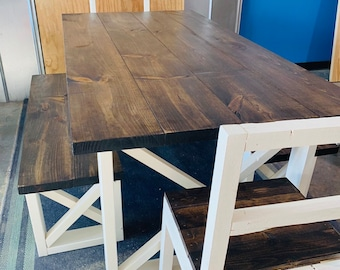 Rustic Farmhouse Table With Benches and Chairs with Dark Walnut Top and Weathered White Base and Cross Brace Design.