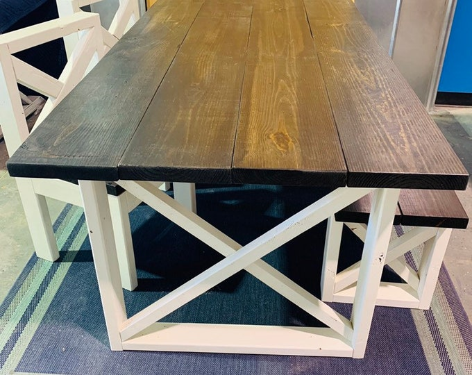 Rustic Farmhouse Table With Bench and Chairs with Dark Walnut Top and Weathered White Base and Cross Brace Design.