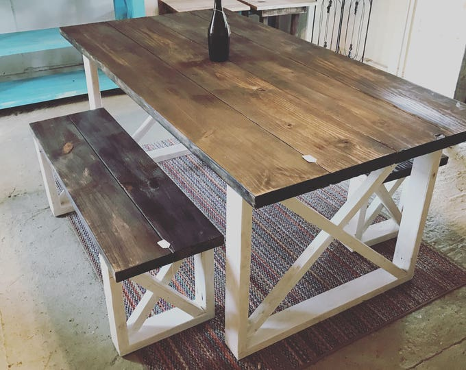Rustic Farmhouse Table With Benches with Dark Walnut Top and Weathered White Base and Cross Brace Design.