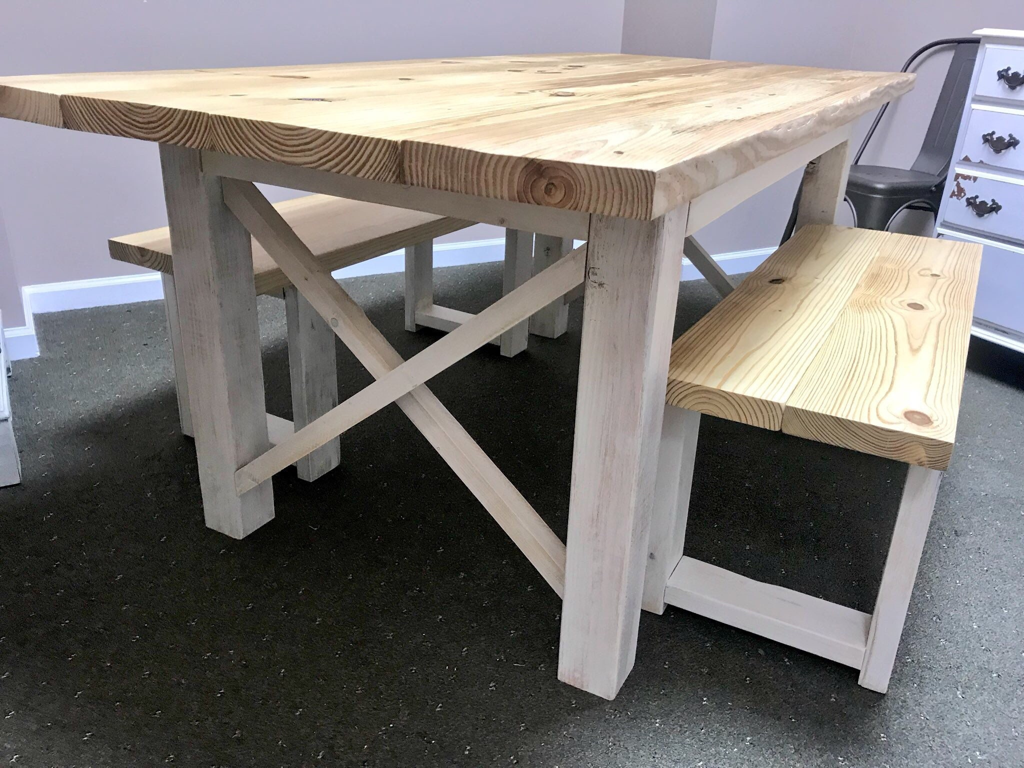 Rustic Farmhouse Table Set With A Natural Top And White Distressed