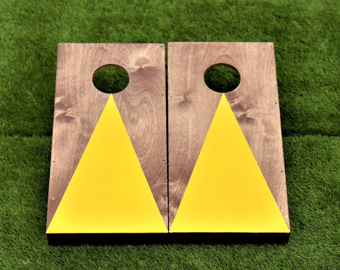 Mini/Kids Cornhole Boards with a light stain and a yellow triangle w/bags included