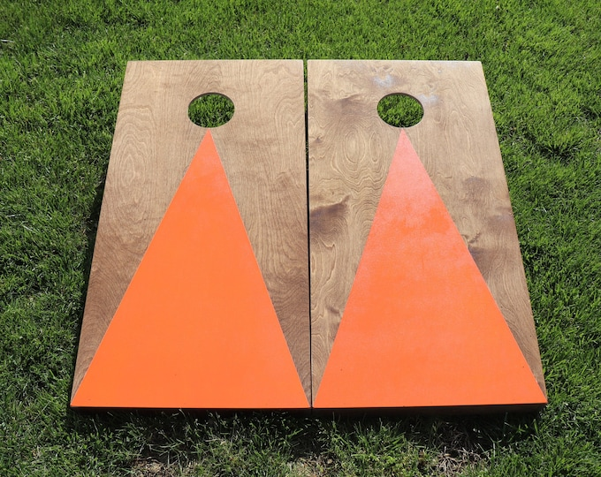 Cornhole Boards with a light stain and Orange triangle w\bags included