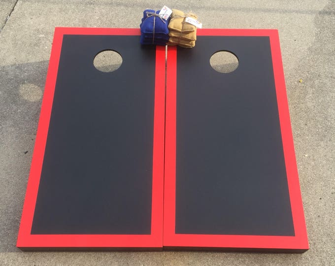 Black Cornhole Boards with a Red Border with 8 bags included.
