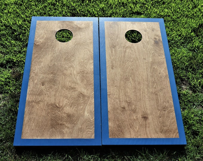Cornhole Boards with a light stain and Royal Blue border w\bags included