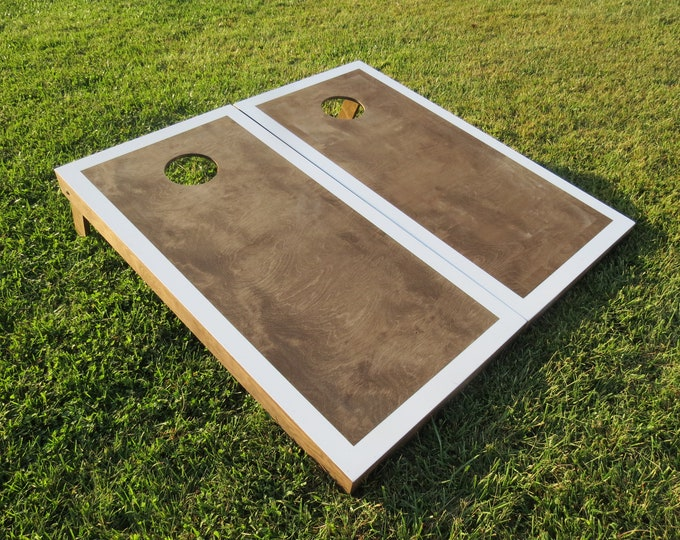 Cornhole Boards with a light stain and White border w\bags included