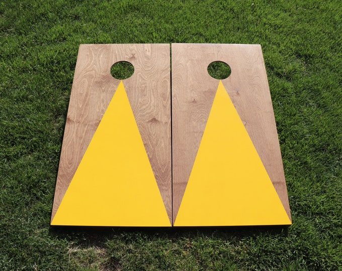 Cornhole Boards with a light stain and Yellow triangle w\bags included