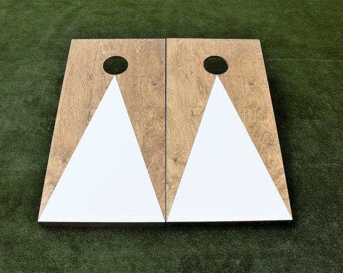 Cornhole Boards with a light stain and White triangle with bags