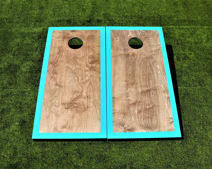 Cornhole Boards with a light stain and Teal border w\bags included