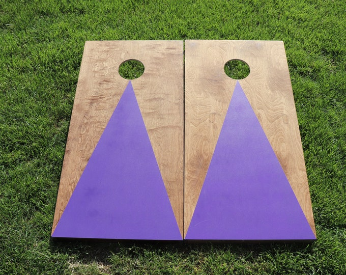 Cornhole Boards with a light stain and Purple triangle w\bags included