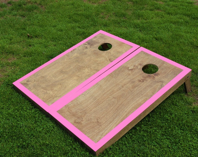 Cornhole Boards with a light stain and pink border