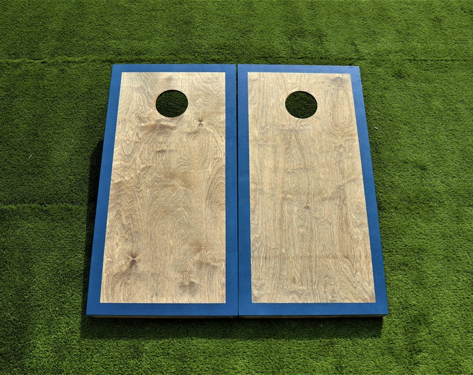 Cornhole Boards with a light stain and Navy Blue border with bags