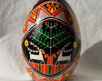Goose egg Pysanky, Traditional Ukrainian Easter egg,  Stags under a pine tree. Bold cross, fish, triangles. Made in Michigan USA