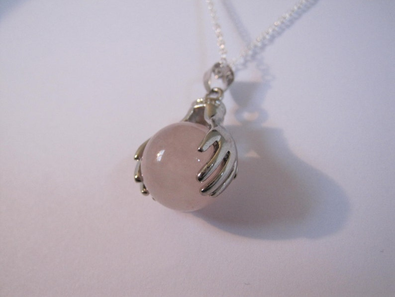 Sweet round Rose Quartz in silver hands pendant with free 925 stamped silver chain