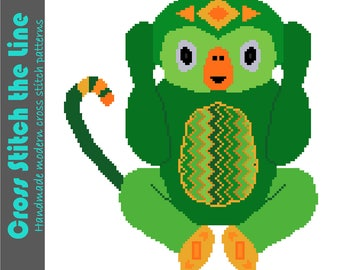 Hear no evil. Contemporary cross stitch pattern of a little monkey in bright greens. Modern design. Tribal embroidery chart.