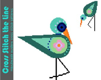 Gorgeous folk Boho cross stitch pattern of wading birds. Modern embroidery chart. Original contemporary design.