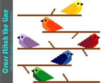 Colorful cross stitch pattern of birds on branches. Modern cross stitch design. Contemporary embroidery chart. Rainbow colors.