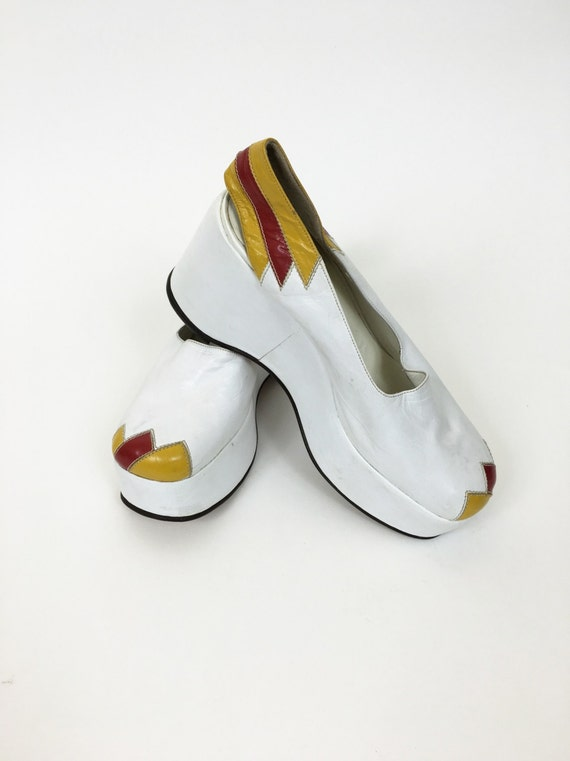 Vintage 1970s white and yellow leather platform we