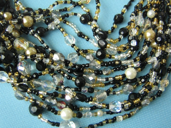 Joan Rivers Black, Gold, and Pearl Multi-Strand Cr