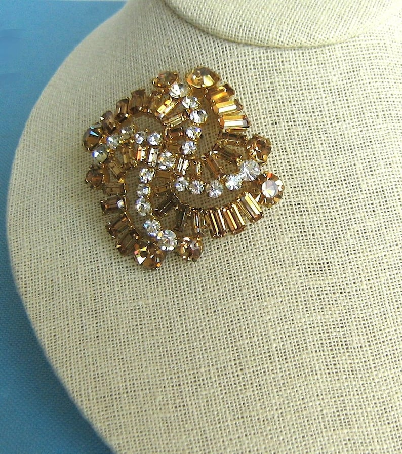 Stunning Made in Austria Faux Topaz and Faux Diamond Gold Tone Pinwheel Brooch and Matching Clip Earrings