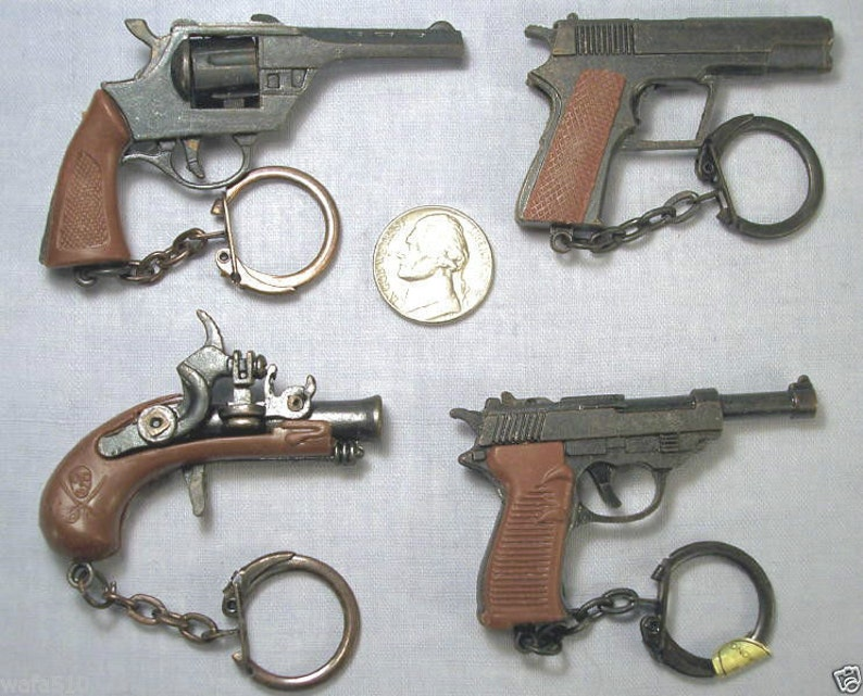 Vintage Mini Pistol Keychains Old stock Dime store cap guns HONG KONG 1970S  4 pcs