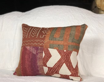 Patchwork tribal cushion in copper tones